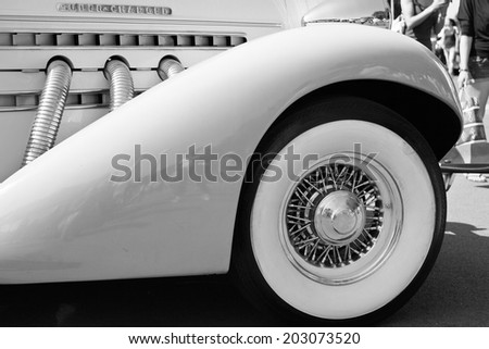 Detail of impeccably maintained classic car in black and white - stock photo