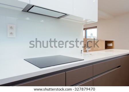 Detail of induction cooker in contemporary kitchen - stock photo