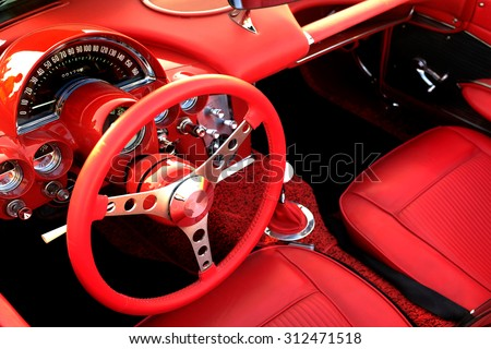 Detail of interior red sports car steering wheel speedometer - stock photo