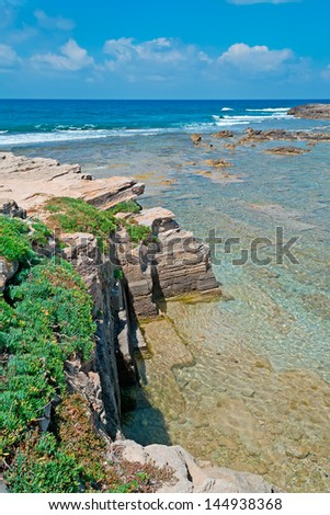 detail of Is Arutas rocky shore on a sunny day