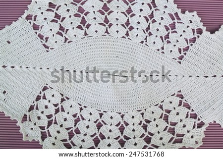 Detail of knitted table cloth - stock photo