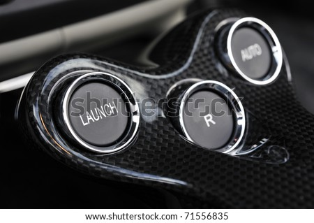 detail of launch control button fitted to a powerful motor car