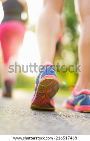 detail of legs during jogging - stock photo