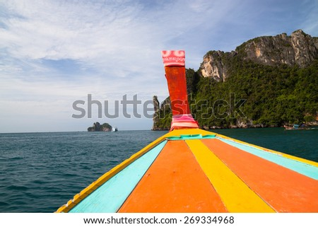 Detail of long tail boat and beautiful scenic coastline of Phi Phi Island in Thailand. - stock photo
