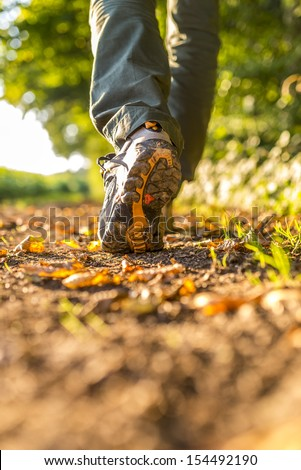 Detail of male hiking on trail. - stock photo