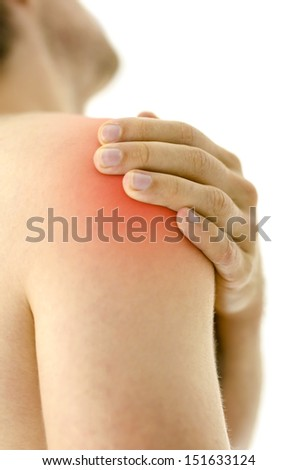 Detail of man holding his painful injured shoulder. Isolated over white background. - stock photo