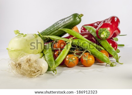 Detail of many vegetables on brown wood table