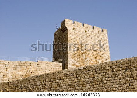 Detail of Medieval Castle tower against blue sky