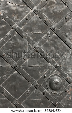 Detail of medieval hammered and riveted gate as texture - stock photo