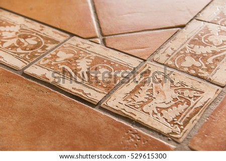 Detail of mediterranean style terracotta floor tiles