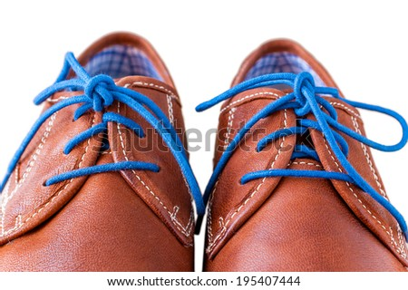 Detail of men's leather shoes with colorful laces - stock photo