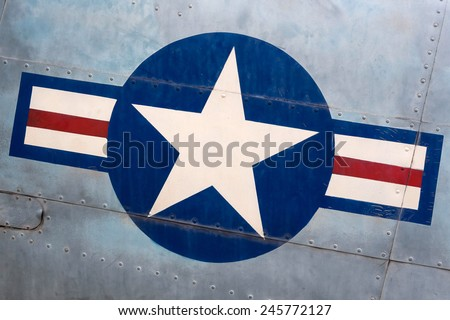 Detail of military airplane fuselage with vintage United States Air Force sign.