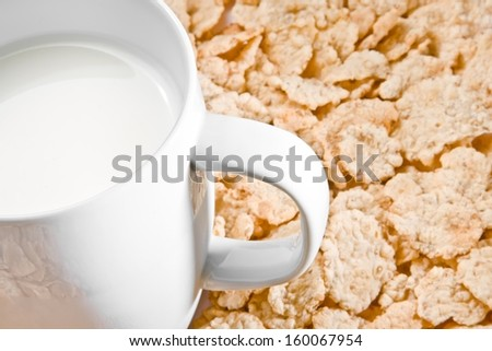 detail of milk on corn flakes background, breakfast concept - stock photo