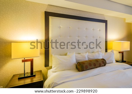 Detail of modern bright bedroom interior in a luxury house - stock photo