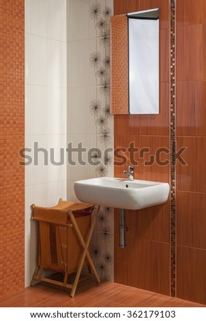 detail of modern private bathroom interior in orange