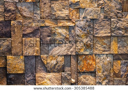 Detail of modern room with stone wall  - stock photo