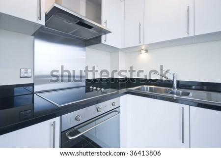 Detail of modern white kitchen witch appliances - stock photo