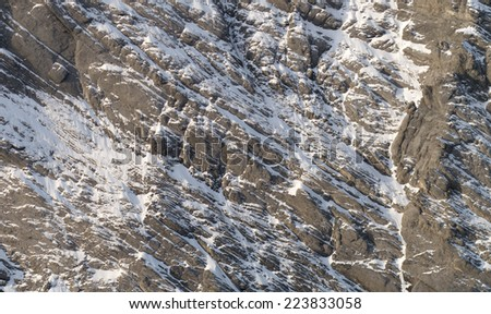 Detail of mountain like matterhorn face with rock and snow