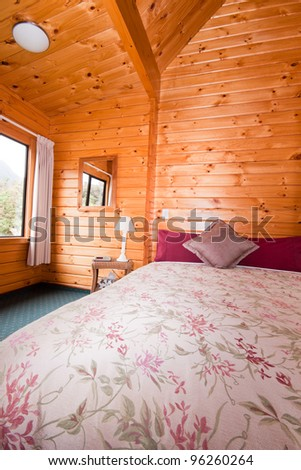 Detail of mountain lodge bedroom. Fox Glacier Lodge, Fox Glacier, West Coast, South Island, New Zealand. - stock photo