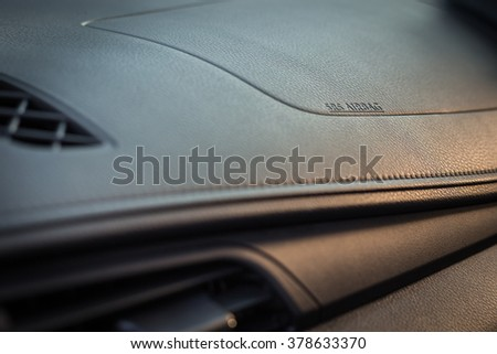 Detail of new modern car interior, Focus on airbag - stock photo