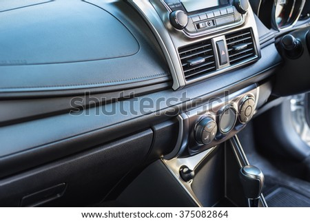 Detail of new modern car interior, Focus on door air-con adjust - stock photo