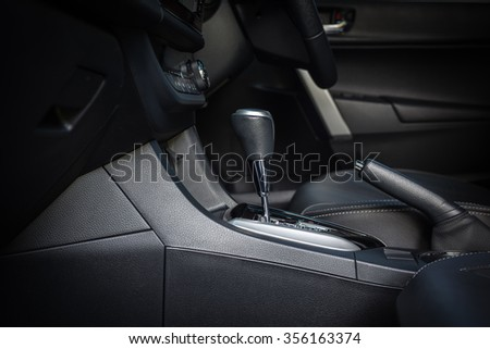 Detail of new modern car interior, Focus on gear - stock photo