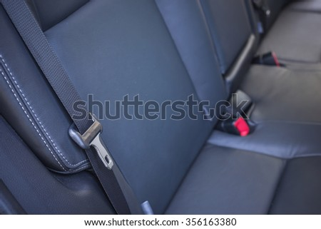 Detail of new modern car interior, Focus on seatbelt - stock photo