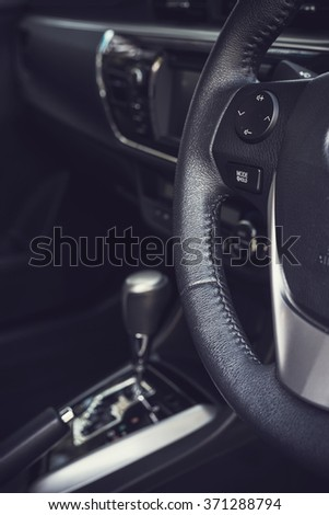 Detail of new modern car interior, Focus on steering