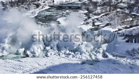 Detail of Niagara's Bridal Veil Falls covered in the ice and snow of a frigid Great Lakes Winter. The image was shot from Niagara Falls, Ontario, Canada. - stock photo