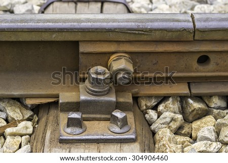 Detail of nuts and bolts on railway rail. Selective focus and shallow dof. - stock photo