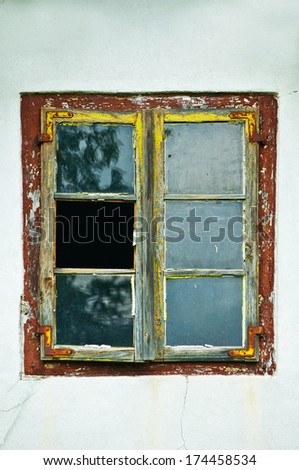 detail of old broken window - stock photo
