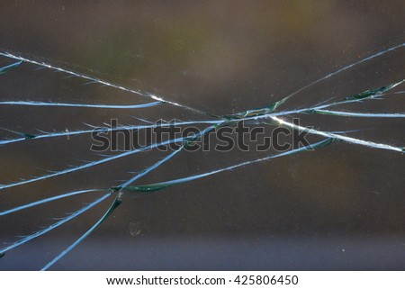 Detail of old dirty cracked glass. - stock photo