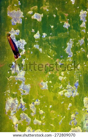 Detail of old metallic door with green peeling paint - stock photo