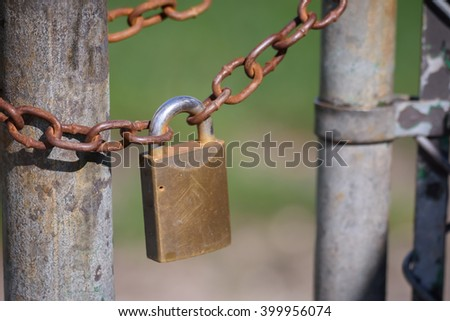 Detail of old, rusty padlock and metal chain./Close up tone