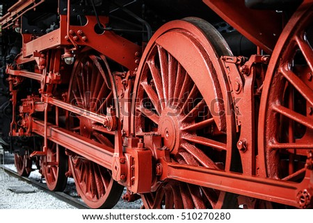 Detail of old Steam Locomotive Wheels painted in red