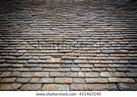 Detail of old stone roof with dark vignette - stock photo