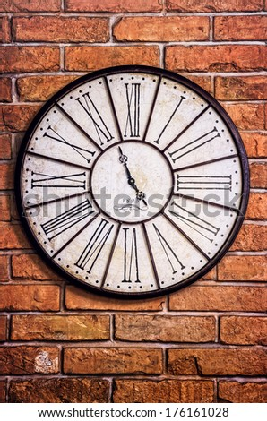 Detail of old vintage clock on textured brick wall - stock photo