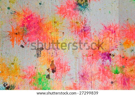 Detail of old wall in abandoned building, covered with paintball marks - stock photo