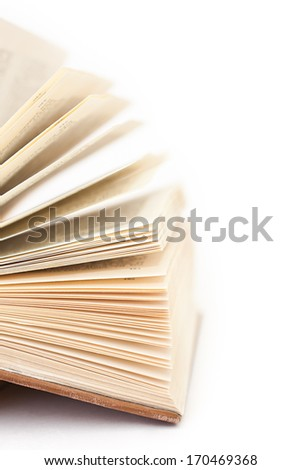 Detail of open book on white background - stock photo