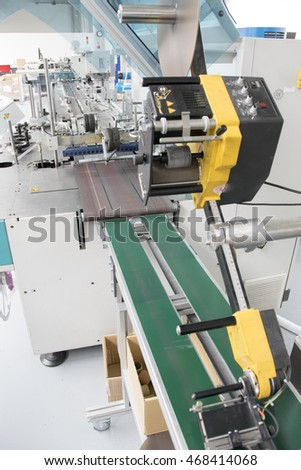 Detail of packaging machine for magazine