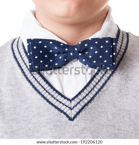 Detail of papillon worn by a young boy against white background.  - stock photo