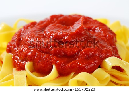 detail of pasta with tomato sauce on top - stock photo