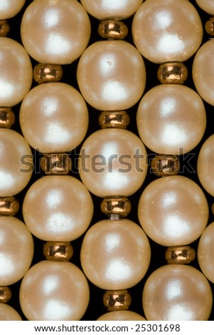 detail of pearl necklace on dark background - stock photo