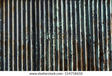 Detail of peeling paint and rust on exterior corrosion wall of abandoned factory - stock photo