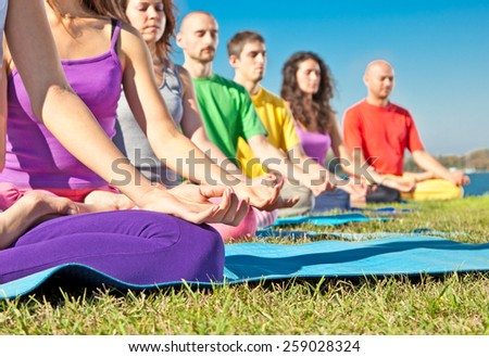 Detail of people in Yoga lotus position. Yoga concept.