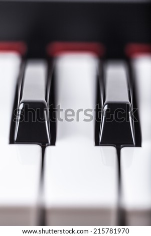 Detail of piano musical instrument keyboard. - stock photo