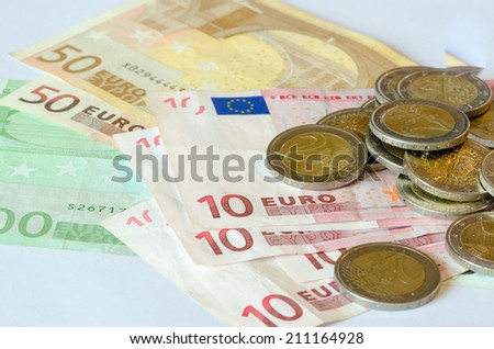 detail of piles of coins isolated - stock photo