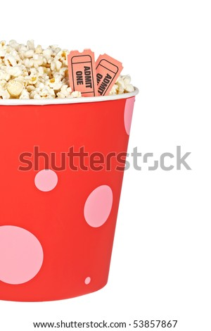 Detail of popcorn in a bucket and two tickets over a white background. Tickets on focus and shallow depth of field
