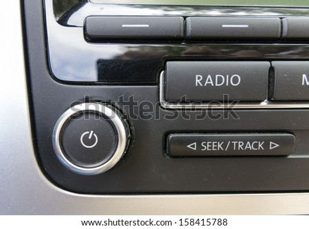 Detail of power switch on a car radio - stock photo
