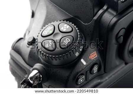 detail of professional digital SLR camera - stock photo